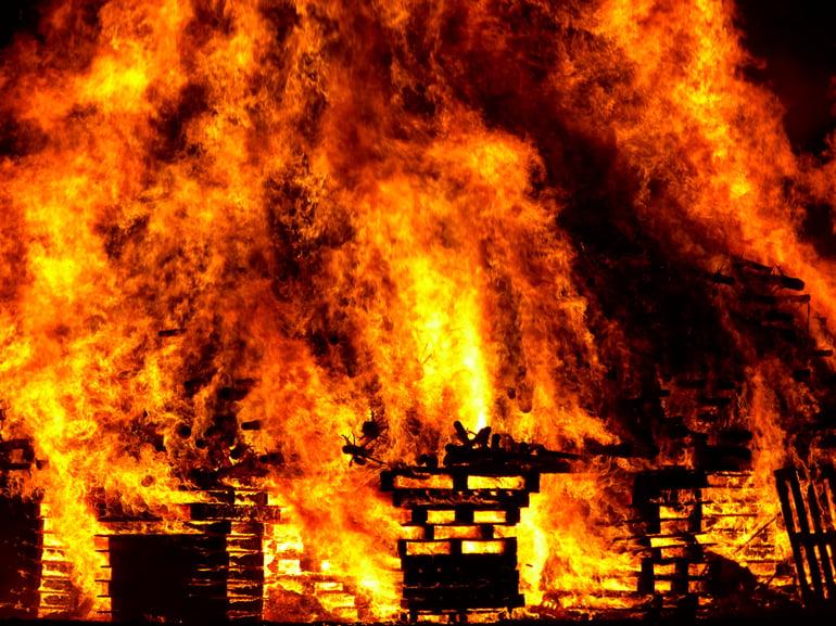 Canva - Burning Brick Building
