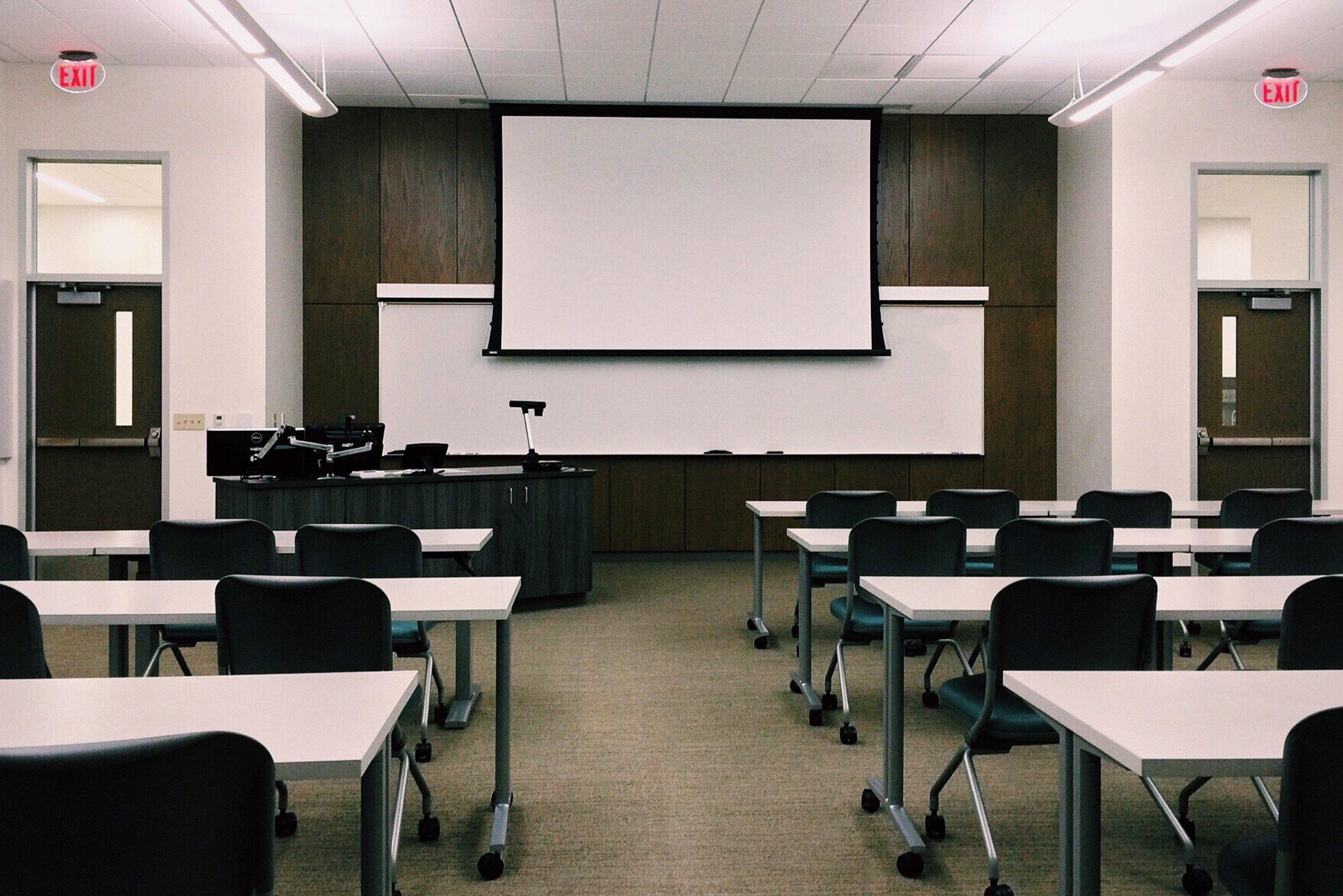 Canva - Empty Classroom with White Board